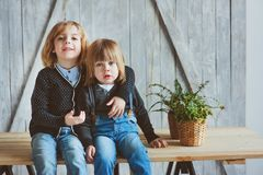 Two happy siblings playing at home in the morning. Casual lifestyle Stock Photos