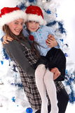 Two Happy Sisters at Christmas Stock Photography