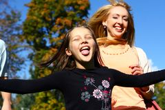 Two happy sisters have fun in park Stock Photo