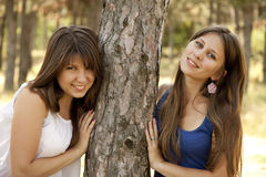 Two happy sisters at the park Royalty Free Stock Images