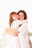 Two happy sisters sitting in bed Stock Images