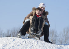 Two happy sisters sledding Stock Photography