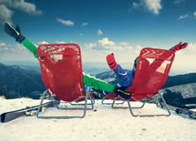 Two happy skiers on the top of mountain Royalty Free Stock Images