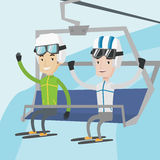 Two happy skiers using cableway at ski resort. Stock Images