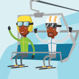 Two happy skiers using cableway at ski resort. Royalty Free Stock Photo