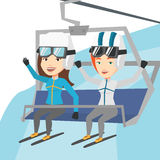 Two happy skiers using cableway at ski resort. Royalty Free Stock Photos