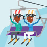 Two happy skiers using cableway at ski resort. Stock Photo