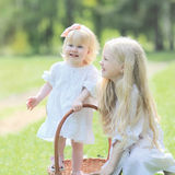 Two happy small sisters smiling royalty free stock images