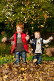 Two happy, smiling brothers playing in  autumn lea Stock Images