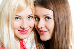Two happy smiling & looking at camera beautiful women friends. Two pretty happy smiling & looking at camera girl friends closeup face portrait Stock Photo