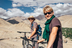 Two happy smiling mountain bikers in Himalaya mountain Stock Photos