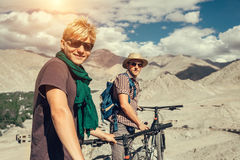 Two happy smiling mountain bikers in Himalaya mountain Stock Images