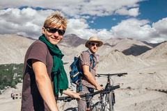 Two happy smiling mountain bikers in Himalaya mountain Royalty Free Stock Photos