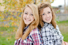 Two happy smiling teen school girls friends outdoors Stock Image