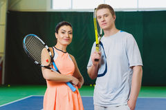 Two Happy smiling Tennis Players posing indoor Royalty Free Stock Photography