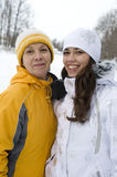 Two happy smiling women in winter jackets and caps Royalty Free Stock Image