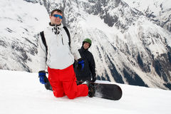 Two happy snowboarders. Two smiling man with snowboards on mountain Stock Image