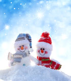 Two happy snowmen  standing in winter landscape Royalty Free Stock Images