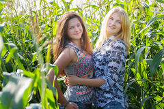 Two happy student friends on rural vacations Stock Images