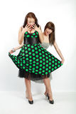 Two happy student girls. In dress stock photography