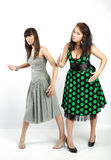 Two happy student girls. In dress playing stock photos