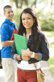 Two Happy Students. Outdoors holding notebooks Royalty Free Stock Photo