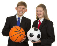 Two Happy Students Holding Ball Stock Photo