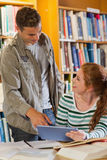 Two happy students studying together using tablet Royalty Free Stock Photos