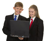Two Happy Students Using Laptop Stock Image