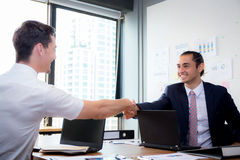Two happy successful business partner shaking hand. Two happy successful business partner shaking hands in the office Stock Photo