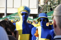 Two happy Sweden fans rooting for their team Royalty Free Stock Images