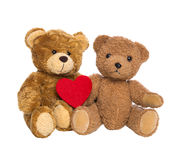 Two happy teddy bears with a red heart isolated on white backgro Royalty Free Stock Image
