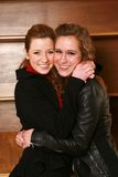 Two happy teen girls hugging Stock Images