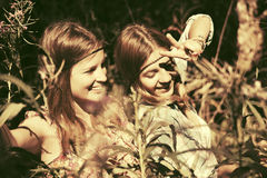 Two happy teen girls walking in summer forest Royalty Free Stock Images