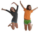 Two happy teenage girls jumping air Stock Photos
