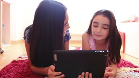 Two happy teenage girls using tablet computer stock video