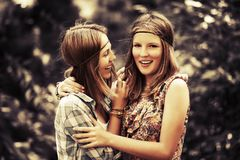 Two happy teen girls walking in summer forest Royalty Free Stock Image