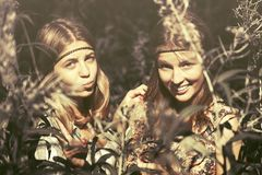 Two happy teen girls walking in summer forest Stock Images