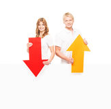 Two happy teenagers holding colorful arrows Royalty Free Stock Images