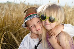 Two happy trendy young children Stock Photo
