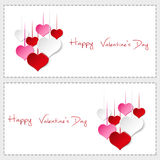 Two happy valentine cards with hanging colorful hearts Stock Images