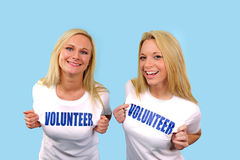 Two happy volunteer girls Stock Image