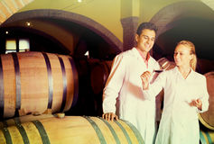 Two happy wine house workers checking quality of product Stock Photo