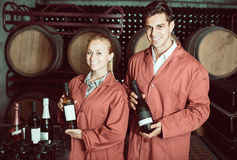 Two happy winery employees in aging section in cellar Stock Photography