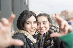 Two happy woman friend selfie. Two women friends selfie gesture her hands Stock Image