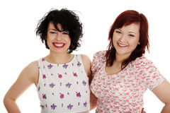 Two happy woman posing Royalty Free Stock Photography