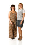 Two happy women. Standing isolated Royalty Free Stock Photos