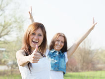 Two happy women. With thumb up stock photos