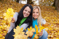 Two happy  women in autumn forest Royalty Free Stock Image