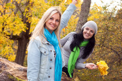 Two happy  women in autumn forest Royalty Free Stock Photos